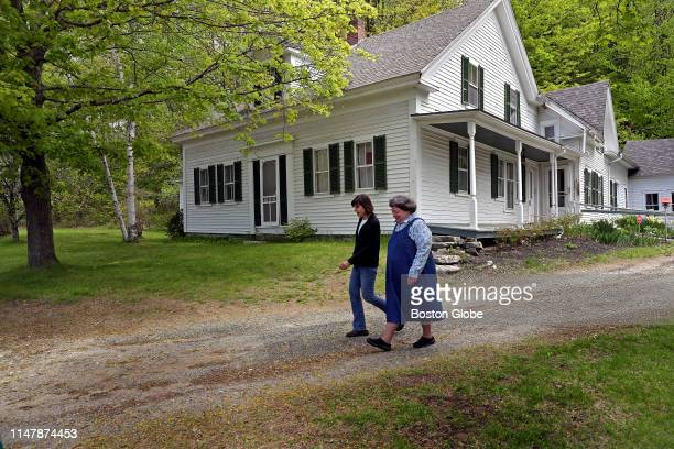 Lynne Monroe and Mary Lyn Ray walk the grounds of the home of late US poet laureate Donald Hall in Wilmot NH on May 23 2019 From 1975 until his death...