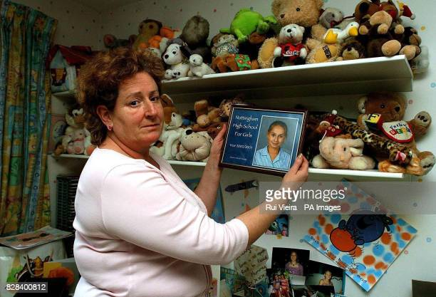 Lynne Morgan holds a picture of her daughter Laura in her daughter's bedroom at her home in Woodborough Nottingham last Wednesday March 15 2006 Laura...