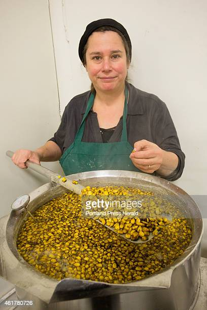 """Lynne Rowe, owner of Tortilleria Panchanga of Portland, stirs """"nixtamal"""", corn steeped in lime, a preliminary step to make tortillas."""