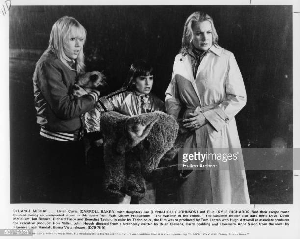 LynnHolly Johnson Kyle Richards and Carroll Baker try to escape in the rain in a scene from the Walt Disney movie The Watcher in the Woods circa 1979