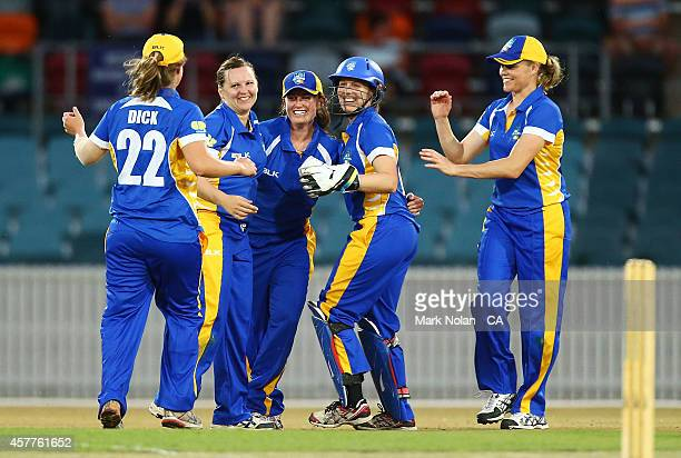 Lynsey Askew celebrates with ACT team mates after taking a wicket during the women's T20 match between the ACT and Victoria at Manuka Oval on October...