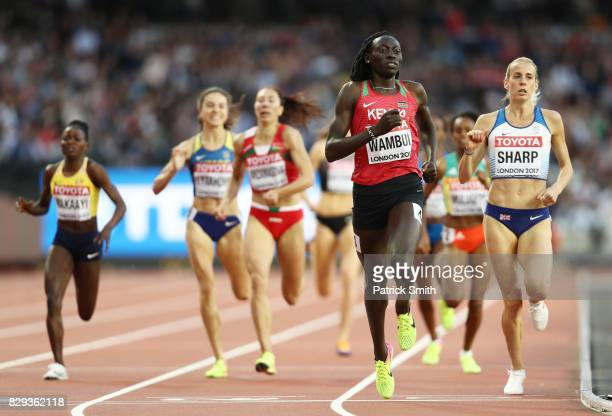 Lynsey Sharp of Great Britain and Margaret Nyairera Wambui of Kenya cross the finish line in the womens 800m heats during day seven of the 16th IAAF...