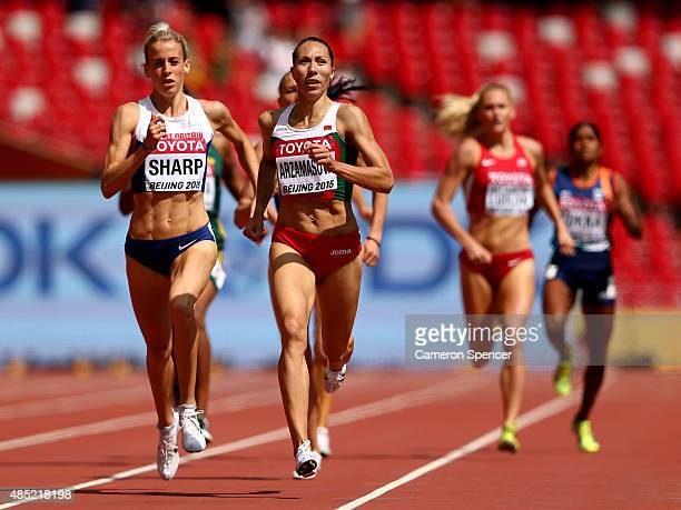 Lynsey Sharp of Great Britain and Marina Arzamasova of Belarus compete in the Women's 800 metres heats during day five of the 15th IAAF World...