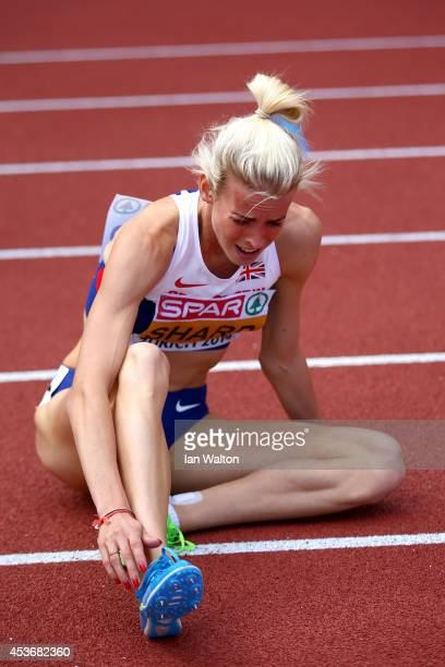 Lynsey Sharp of Great Britain and Northern Ireland rests on the track after winning silver in the Women's 800 metres final during day five of the...