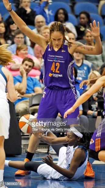 Lynx Asia Taylor looked to pass the ball as Phoenix center Brittney Griner towered over her ] Minnesota Lynx vs Phoenix Phoenix won 8072MARLIN...