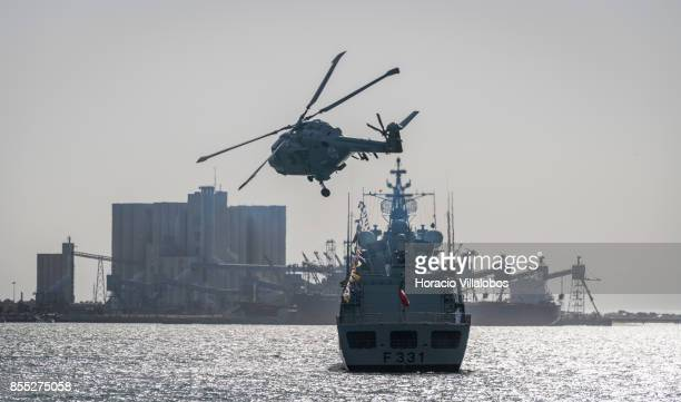 Lynx helicopter performs aerobatics over Tagus River during the commemoration of the 100th anniversary of Portuguese Naval Aviation on September 28...