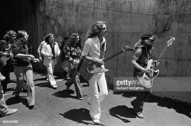 Lynyrd Skynyrd approach the stage at the Oakland Coliseum in 1976 in Oakland California