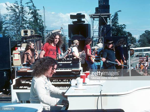 Lynyrd Skynyrd [LR Artimus Pyle Allen Collins Billy Powell Leon Wilkeson Steve Gaines and Ronnie Van Zant ] perform live at a music festival in...