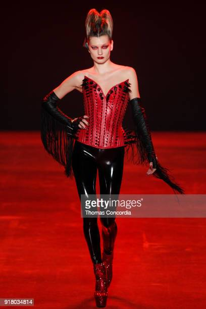 Lyoka Tyagnereva walks the runway wearing The Blonds Fall 2018 Collection with makeup by Kabuki Magic and the MAC Pro team hair by Kien Hoang and...