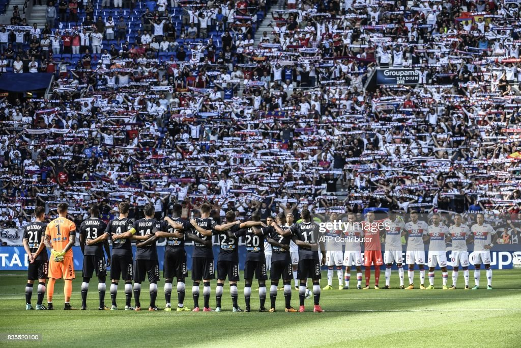 Lyon and Bordeaux' players observe a minute silence in tribute to the victims of Barcelone's attack prior to the the L1 football match Olympique Lyonnais (OL) vs FC Girondins de Bordeaux (FCGB), on August 19, 2017 at the Groupama stadium in Décines-Charpieu near Lyon, southeastern France. /