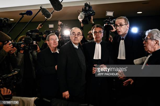 Lyon archbishop cardinal Philippe Barbarin flanked by journalists and lawyers arrives in Lyon court to attend his trial on January 7 charged with...