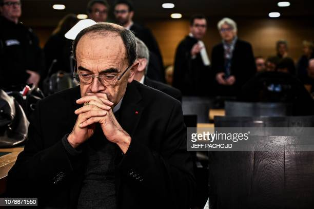 TOPSHOT Lyon archbishop cardinal Philippe Barbarin gestures as he arrives in Lyon court to attend his trial on January 7 charged with failing to...