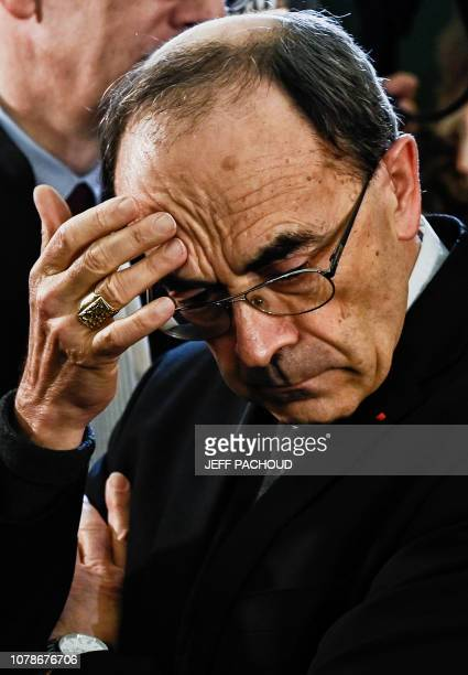Lyon archbishop cardinal Philippe Barbarin gestures as he arrives in Lyon court to attend his trial on January 7 charged with failing to report a...