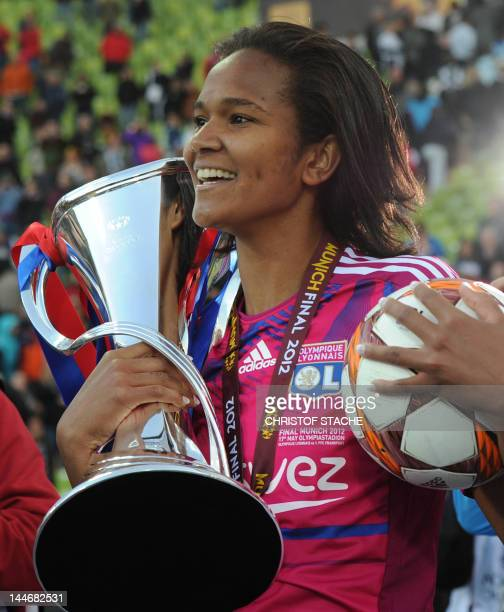 Lyon defender Wendie Renard celebrates with the trophy after the UEFA Women's Champions League final football match of Olympique Lyonnais vs 1 FFC...