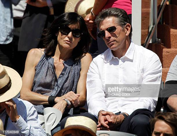 Lyon football team's coach Claude Puel and his wife Corinne attend the match between Spain's Rafael Nadal and Sweden's Robin Soderling during the...
