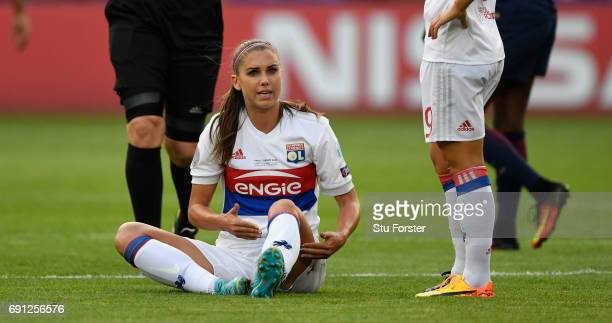 Lyon forward Alex Morgan reacts after an injury forces her to leave the field during the UEFA Women's Champions League Final between Lyon and Paris...