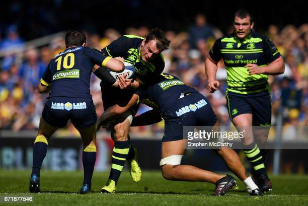 Lyon France 23 April 2017 Rhys Ruddock of Leinster is tackled by Camille Lopez left and Sébastien Vahaamahina of ASM Clermont Auvergne during the...