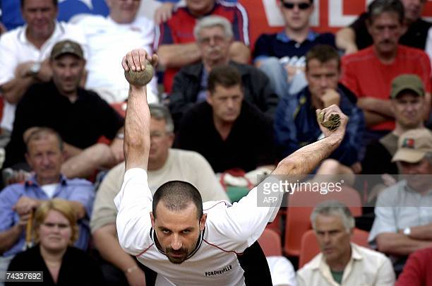 French traditional Lyon's lawn bowling player Noel SaintJores throws a boule 26 May 2007 in Lyon on the first day of the 95th edition of Lyon Pencote...