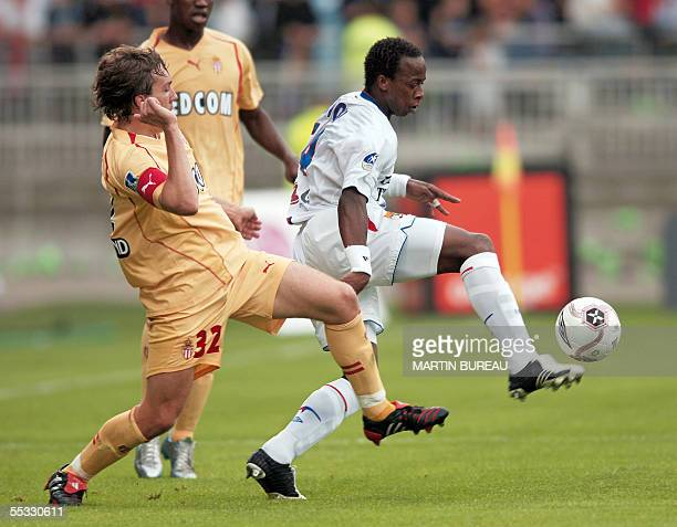 Lyon's French forward Sidney Govou fights for the ball with AS Monaco's French defender Gael Givet during their French L1 football match at the...