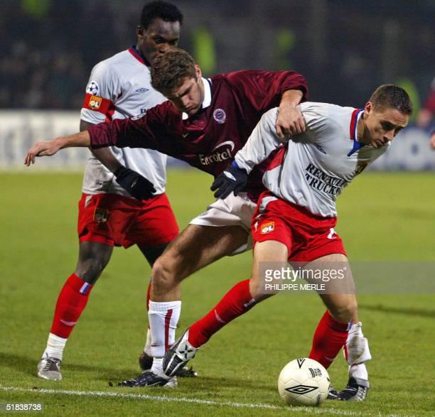 Lyon's midfielder Florent Malouda and Lyon's defender Yohan Gomez vies with Sparta Prague' forward Michael Meduna during their group D Champions...