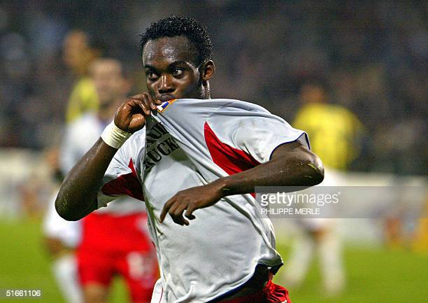 Lyon's midfielder Ghana Mickal Essien jubilates after jubilates after scoring a goal during the Champions League football match against Turkish club...