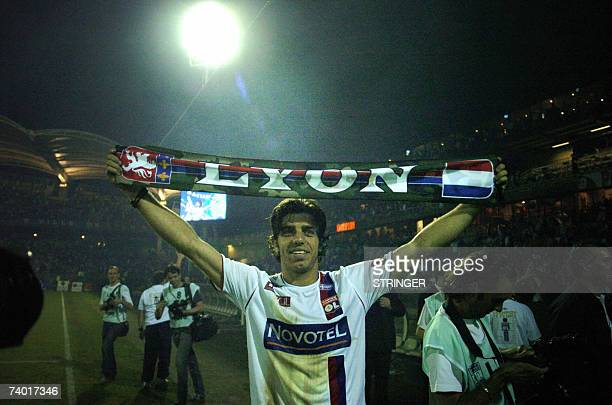Lyon's team captain Juninho celebrates his team's sixth French champions title in a row at the end of their French L1 football match against Le Mans...