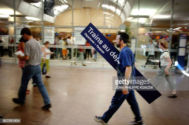 Lyon Part-Dieu train station employee carries a sign during a strike limiting the railway traffic 02 June 2005. Rail traffic in France was badly hit...