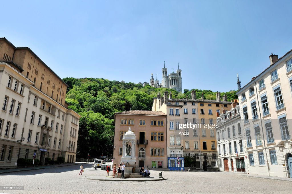 'place Saint-Jean' square. In the background, Notre-Dame de Fourviere Basilica, registered as a National Historic Landmark (French 'Monument Historique').