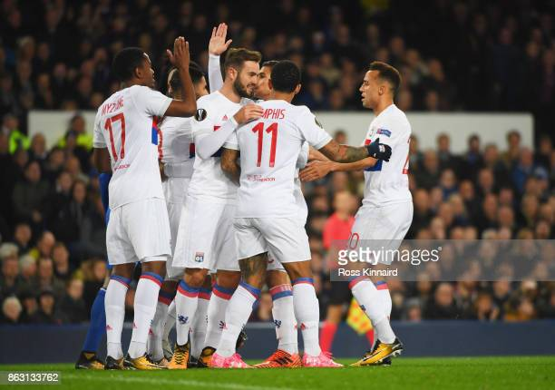 Lyon player celebrate as Nabil Fekir of Lyon scores their first goal from the penalty spot during the UEFA Europa League Group E match between...