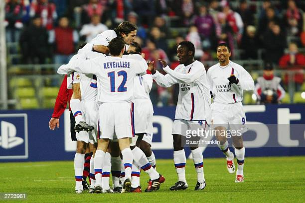 Lyon players celebrate a goal during the UEFA Champions League Group A match between FC Bayern Munich and Olympique Lyonnais held on November 5 2003...