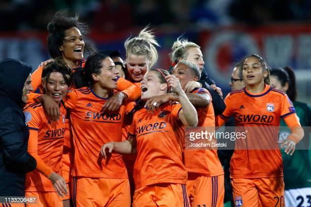 Lyon players celebrate after the UEFA Women's Champions League Quarter Final Second Leg match between Wolfsburg and Lyon at AOK Stadion on March 27...