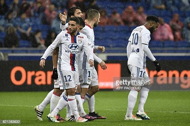 Lyon players celebrate Bastia's own goal during the French L1 football match Olympique Lyonnais vs Bastia on November 5 at the Parc Olympique...