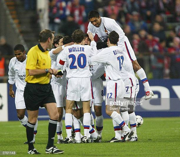 Lyon players celebrate the first goal scored by Juninho during the UEFA Champions League match between FC Bayern Munich and Olympic Lyonaise on the...