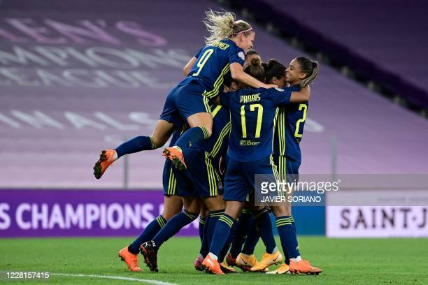 Lyon players celebrate their second goal during the UEFA Women's Champions League quarter-final football match between Lyon and Bayern Munich at the...