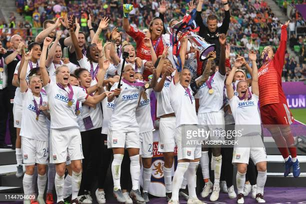 Lyon players celebrate with the trophy after the UEFA Women's Champions League final football match Lyon v Barcelona in Budapest on May 18 2019