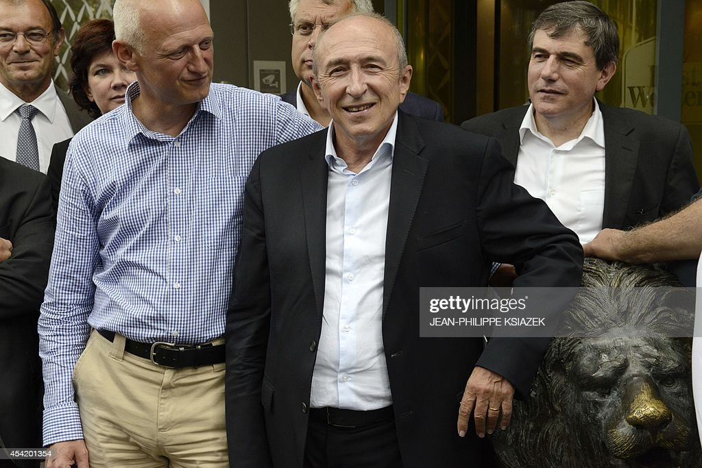 Lyon socialist mayor Gerard Collomb (C) flanked with Christophe Caresche (L) poses during a meeting of the 'Pôle des réformateurs' (Pole of reformers) on August 26, 2014 in Lyon.