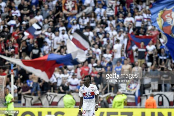 Lyon supporters cheer after Lyon's Burkinabe forward Bertrand Traore scored a goal during the French L1 football match Olympique Lyonnais vs ESTAC...