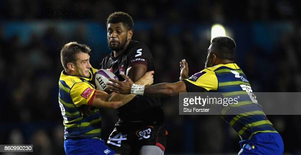 Lyon wing Timilai Rokoduru is sandwiched between Blues centres Garyn Smith and Rey LeeLo during the European Rugby Challenge Cup Match between...
