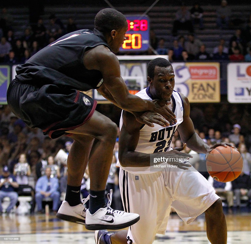 Lyonell Gaines #1 of the IUPUI Jaguars jumps as Khyle Marshall #23 of the Butler Bulldogs dribbles to the hoop at Hinkle Fieldhouse on December 5, 2012 in Indianapolis, Indiana. Butler defeated IUPUI