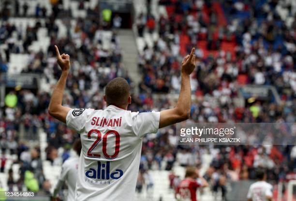 Lyon's Algerian forward Islam Slimani celebrates after scoring his team's first goal during the French L1 football match between Lyon and Brest , at...