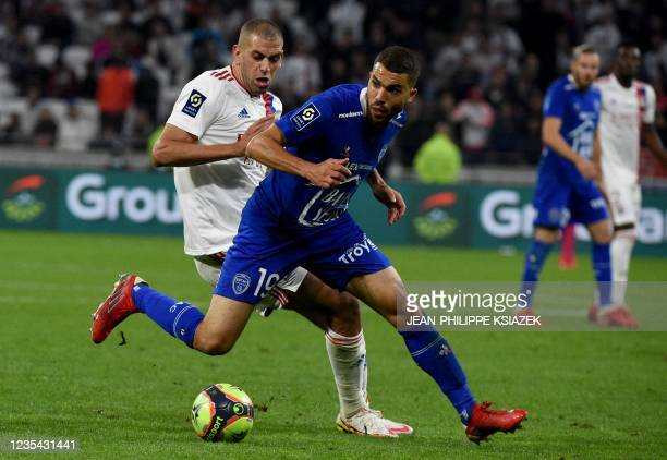 Lyon's Algerian forward Islam Slimani fights for the ball withTroyes' Moroccan defender Oualis El Hajjam during the French L1 football match between...