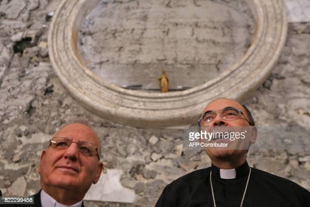 Lyon's Archbishop Cardinal Philippe Barbarin and Louis Raphael Sako the Patriarch of the Chaldean Church in Iraq speak as they visit the church of...