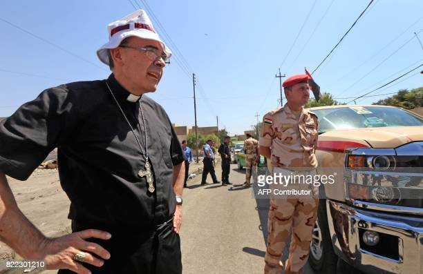 Lyon's Archbishop Cardinal Philippe Barbarin arrives to the Martyr's Church during a visit to east Mosul on July 25 2017 Barbarin hailed the...
