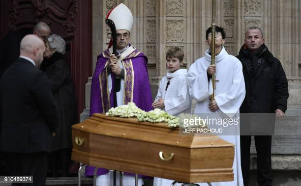 Lyon's Archbishop Cardinal Philippe Barbarin stands by the coffin French chef Paul Bocuse outside the SaintJean Cathedral in Lyon on January 26 2018...