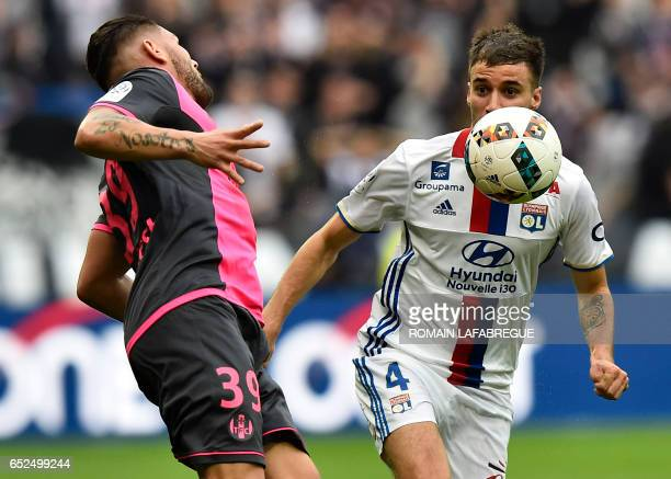 Lyon's Argentin defender Emanuel Mammana vies with Toulouse's French forward Andy Delort during the French L1 football match between Olympique...