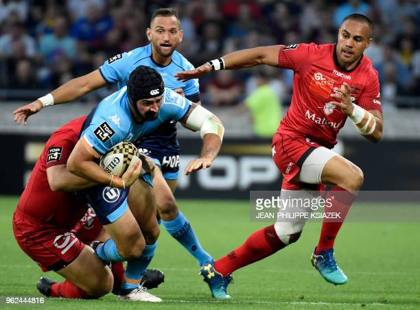 Lyon's Argentinian prop Francisco GomezKodela vies with Montpellier's French number eight Alexandre Dumoulin during the French Top 14 union semifinal...