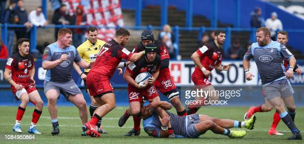 Lyon's Australian flanker Liam Gill is tackled by Cardiff Blues' Samoan centre Rey LeeLo during the European Rugby Champions Cup pool 3 rugby union...