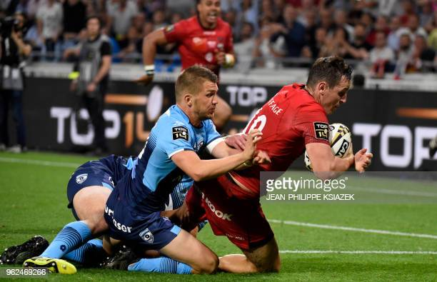 Lyon's Australian fly-half Michael Harris scores during the French Top 14 union semi-final rugby match between Montpellier and Lyon on May 25, 2018...