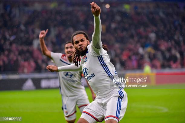 Lyon's Belgian defender Jason Denayer celebrates after scoring a goal during the French L1 football match between Lyon and Saint-Etienne on November...