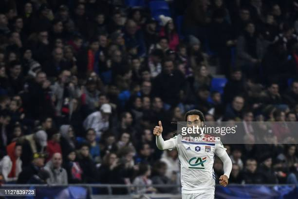 Lyon's Belgian defender Jason Denayer celebrates after scoring during the French Cup quarter-final football match between Olympique Lyonnais and...